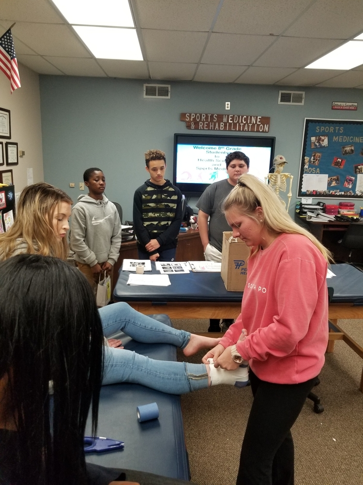 Health Science & Sports Medicine Students provide mock physicals and demonstrations to 8th grade students.