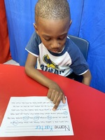 Kindergarten practicing reading and writing skills