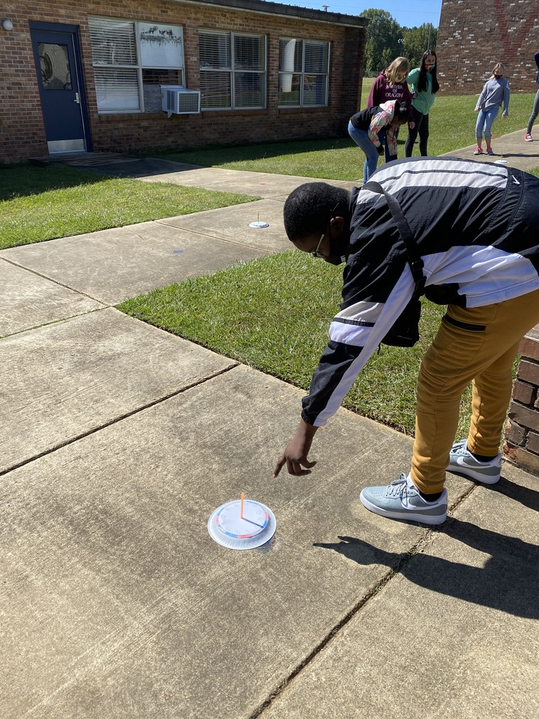 Students making sundials