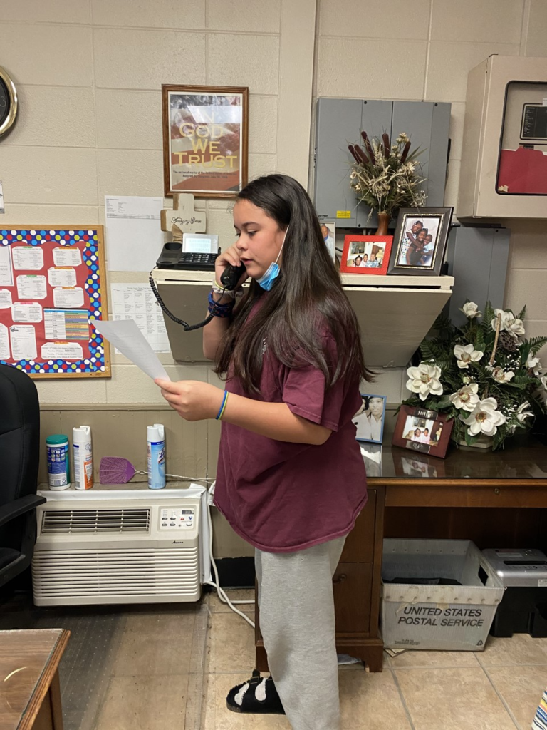 6th grade student reading morning announcements.