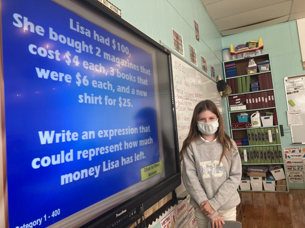 Students played a game of Jeopardy to review their math skills in fifth grade.