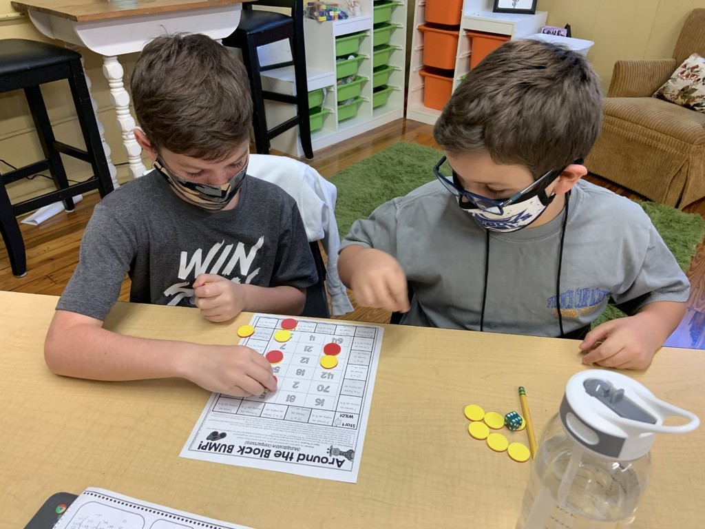 Students in Mrs. Chesteen's class play games to help them learn about multiplicative comparisons.