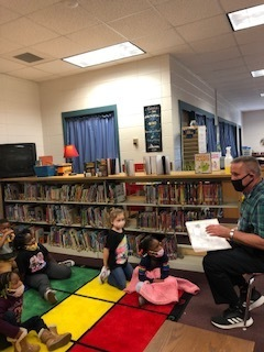 Mr. Ballard having a great time entertaining the children at WES.