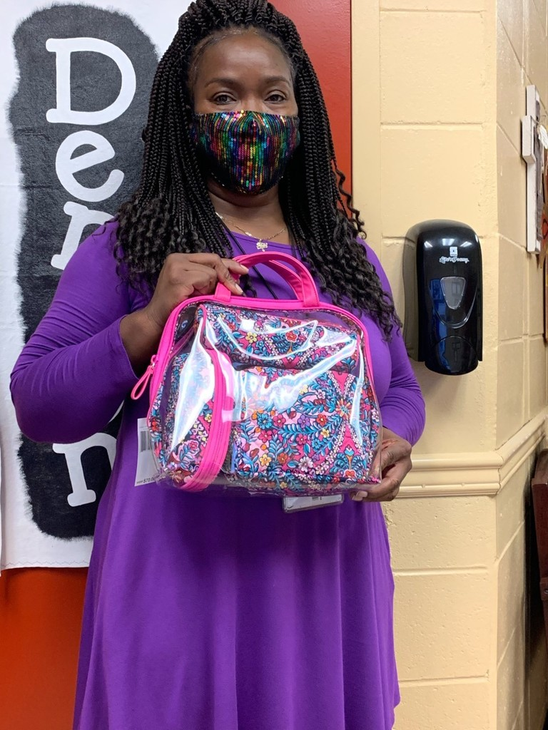 Ms. Conerly won the drawing for having perfect attendance in October.