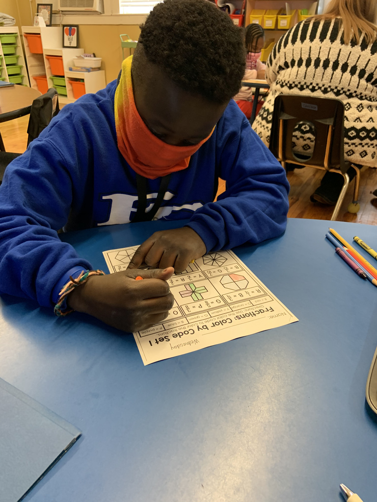 Nate works on fractions in Mrs. Chesteen's class.
