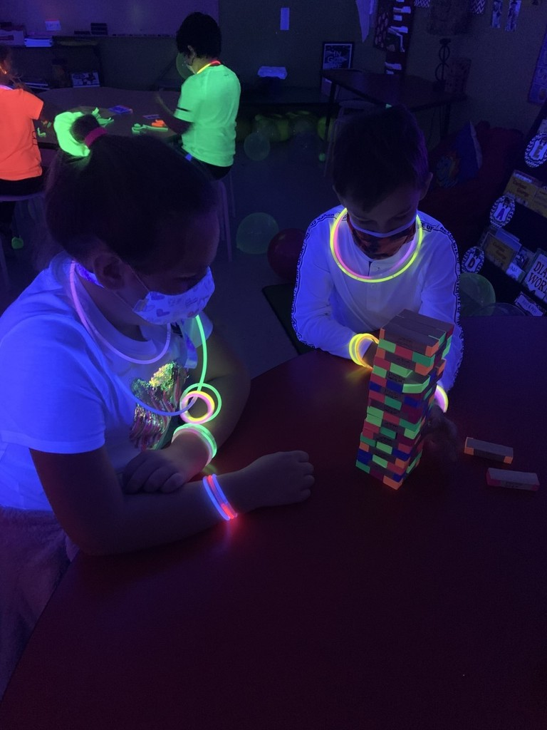Mrs. Alexander and Mrs. Riddell's Second Grade class at FCE celebrated being 100 days brighter with a Glow Day Party!