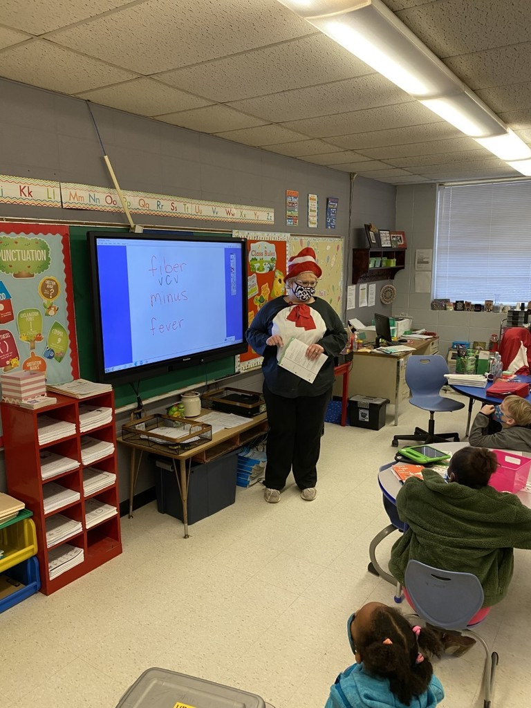 Mrs. Martin decked out as The Cat in the Hat teaching first graders Saxon Phonics.