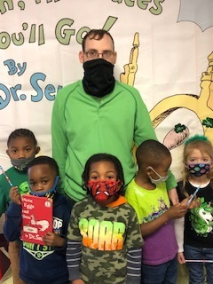 Students at Weir Elementary School enjoy reading and hearing Green Eggs and Ham by Dr. Seuss. Most of the students can recite much of the book. They do it with lots of expression. Pictured are Mr. Stoney Armstrong and some of our  pre-k students wearing green as part of our Dr. Seuss reading celebration at WES.