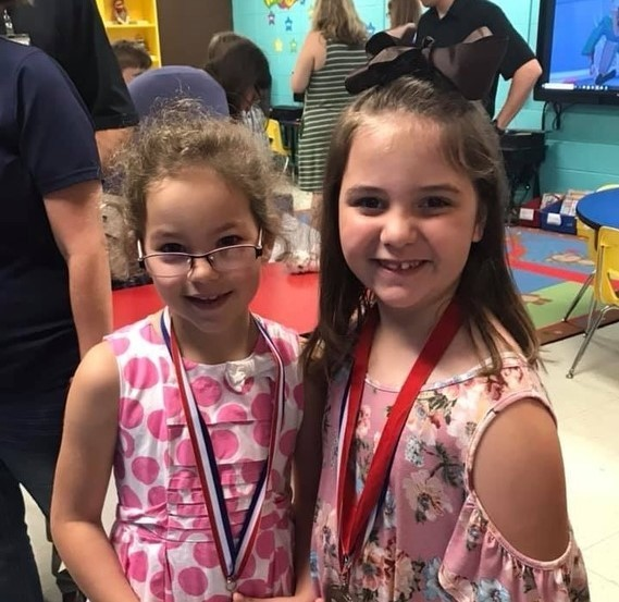 Two elementary students at awards day.