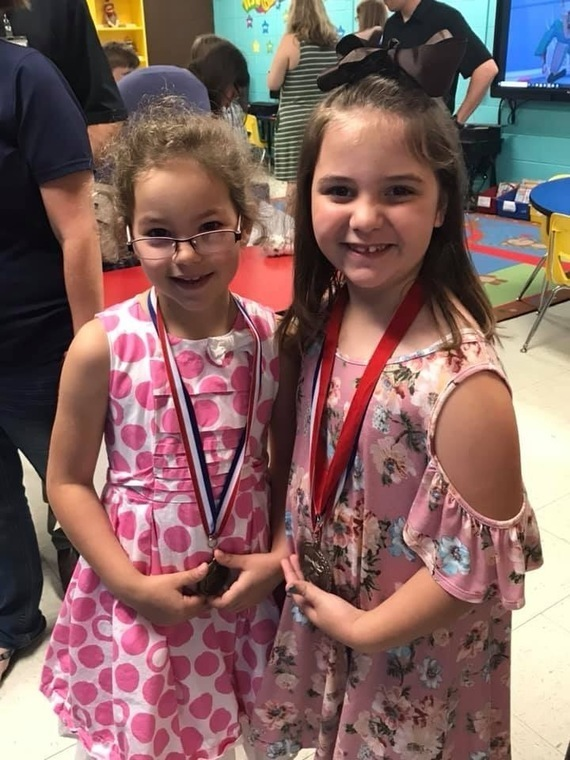 Two elementary students on awards day.