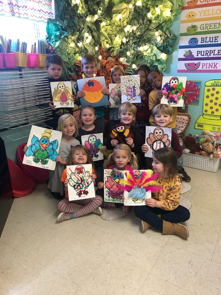 FCE students displaying their turkeys.