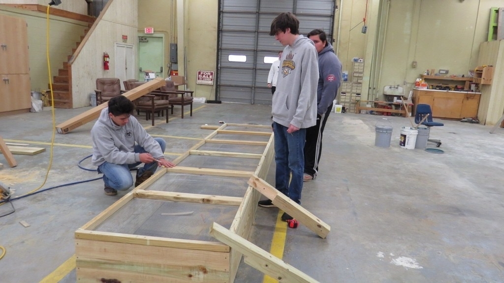 Carpentry students building raised beds.