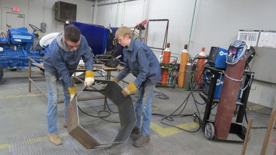 Two students working on pit