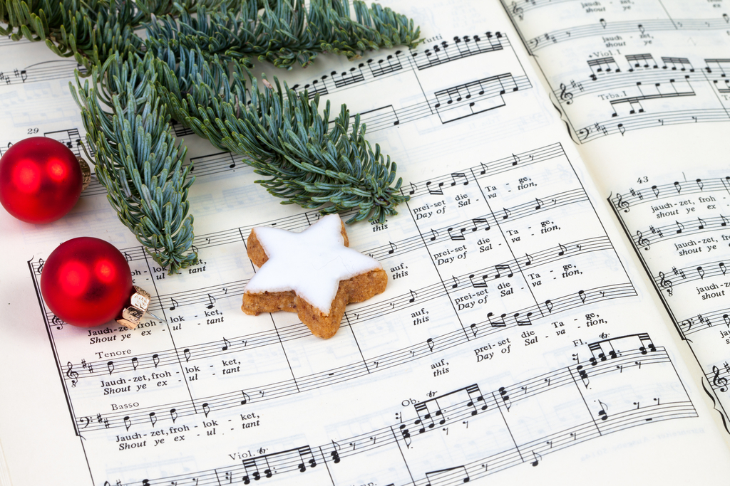 Music with ornament, star cookie, and part of a tree