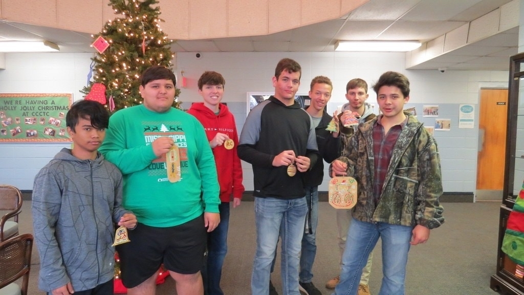 CCCTC carpentery students with Christmas ornaments