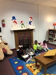Students reading books at WES.