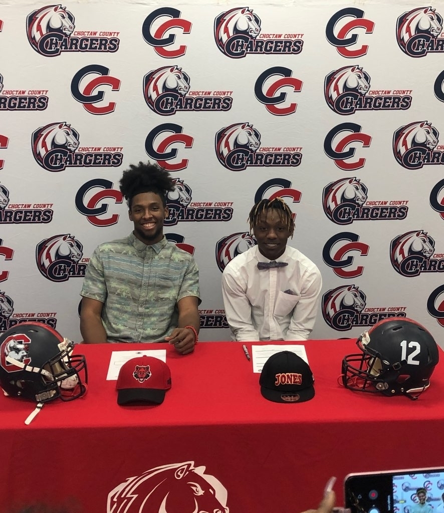 Isreal and Kendell signed football scholarships.