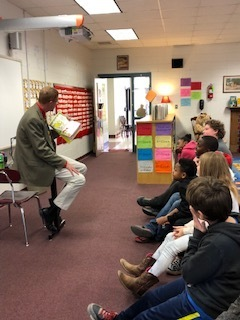 Mr. Blaine reads to WES fourth grade students