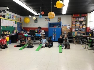 1st Grade Students roll their cars from different heights and measure how far they roll.