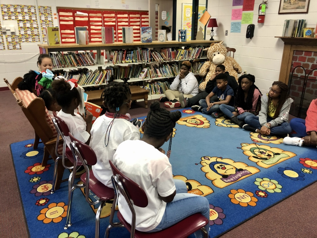 WES Kindergarten reads to 6th grade students.